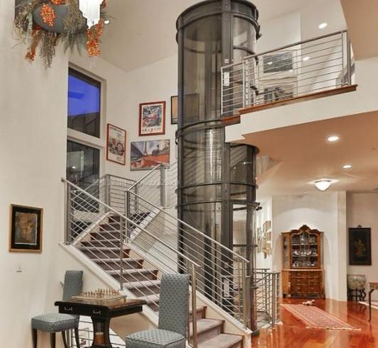这个圆弧形别墅电梯大大提升了别墅档次